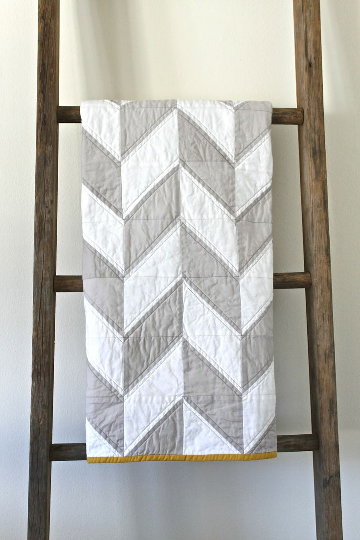 I should probably learn how to make quilts before my grandma gives up on making them.  I like this chevron one, simple and cute.