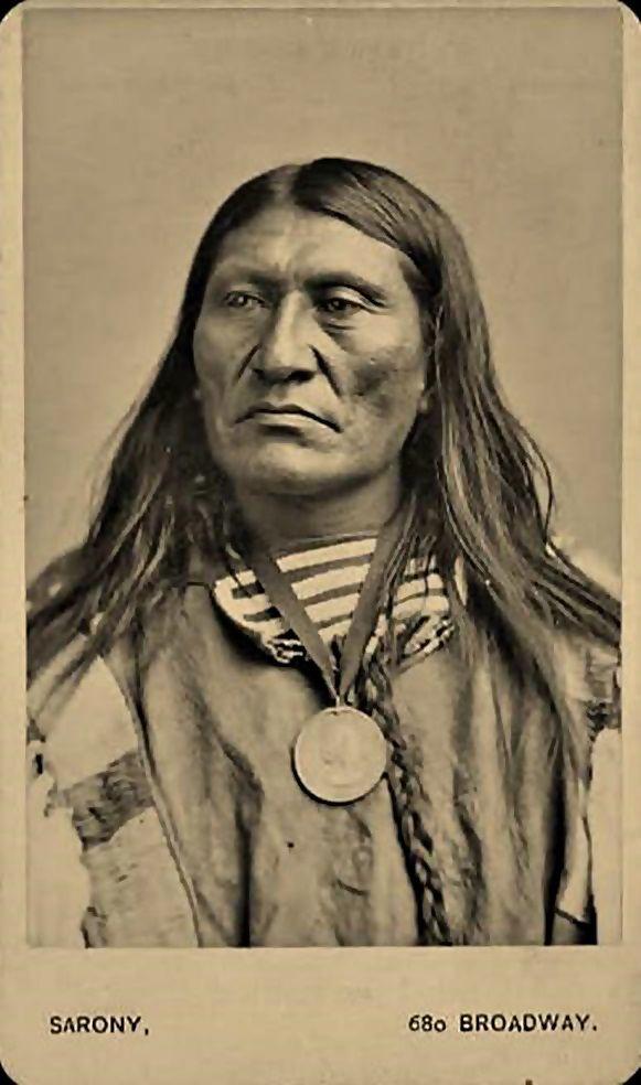 Kam-Ne-But-Sa (aka Sits In The Middle Of The Land, aka Black Foot) - Crow - circa 1873