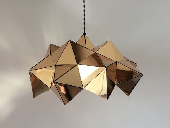 This is a listing for a Golden Mirrored polystyrene Light. Handmade, hand-cut, hand-glued with industrial grade adhesive on clear PVC material, to be