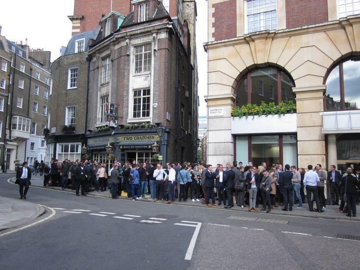 This is what Londoners do after work to avoid the rush hour on the tube. Taken by me at The Two Chairmen pub.