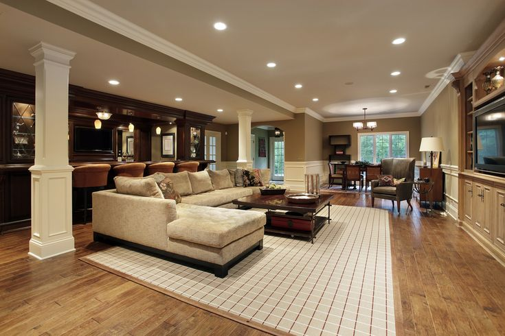 Huge man cave with sectional sofa, bar, recessed lighting and hard wood floor