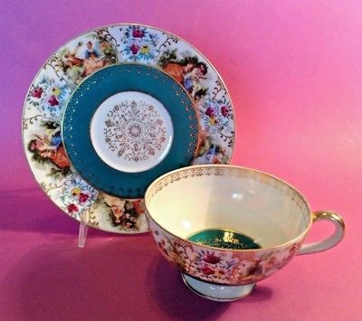 Hand Painted Teal Tea Cup And Saucer With Renaissance Couples - Japan