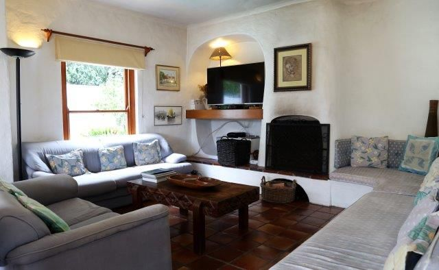 142 on 10th Street: down stairs lounge/living room. FIREFLYvillas, Hermanus, 7200 @fireflyvillas ,bookings@fireflyvillas.com,  #142on10thStreet #FIREFLYvillas #HermanusAccommodation