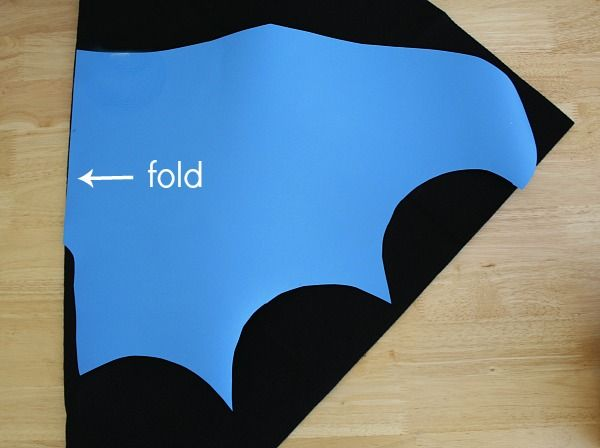 Bat wing template on black felt