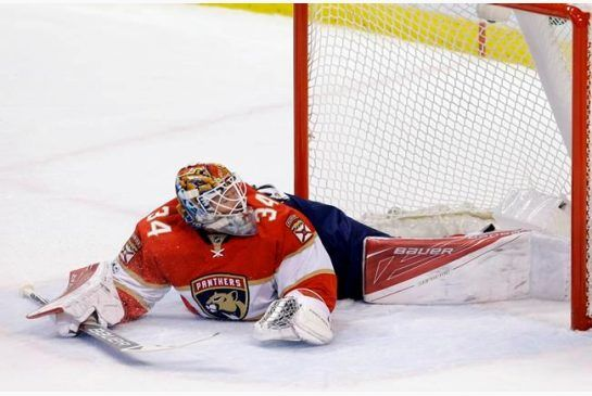 Florida Panthers goalie James Reimer (34) is unable to stop a shot by Boston Bruins left wing Brad Marchand (63) in the first period of an NHL hockey game in Saturday, Jan. 7, 2016 in Sunrise, Fla. (AP Photo/Alan Diaz)