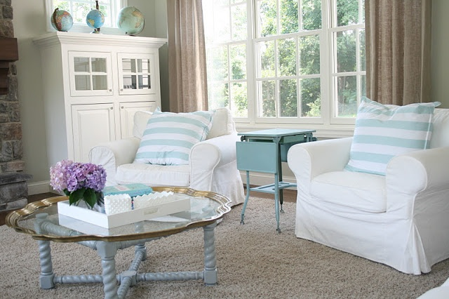 August Fields - the fun teal table she has as an end table b/t the chairs. also the simple curtains.