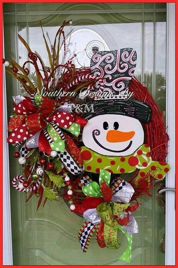 This large beautiful snowman wreath is perfect to bring in the holidays! It is made onto a 24 vine wreath with a 24L wooden snowman attached.