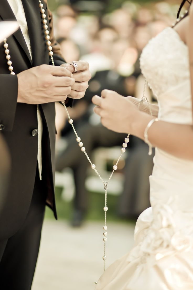 We are thinking about incorporating the wedding lasso, a Mexican/Catholic tradition.