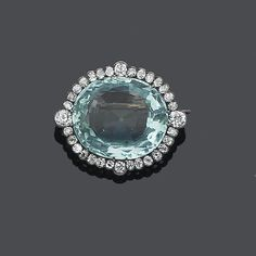 A late 19th century aquamarine and diamond brooch …