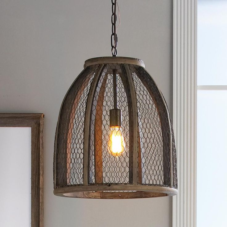 Large Chicken Wire Pendant Light with mesh wire wrapped around a distressed wood frame, this pendant is perfect as a single or as several grouped together