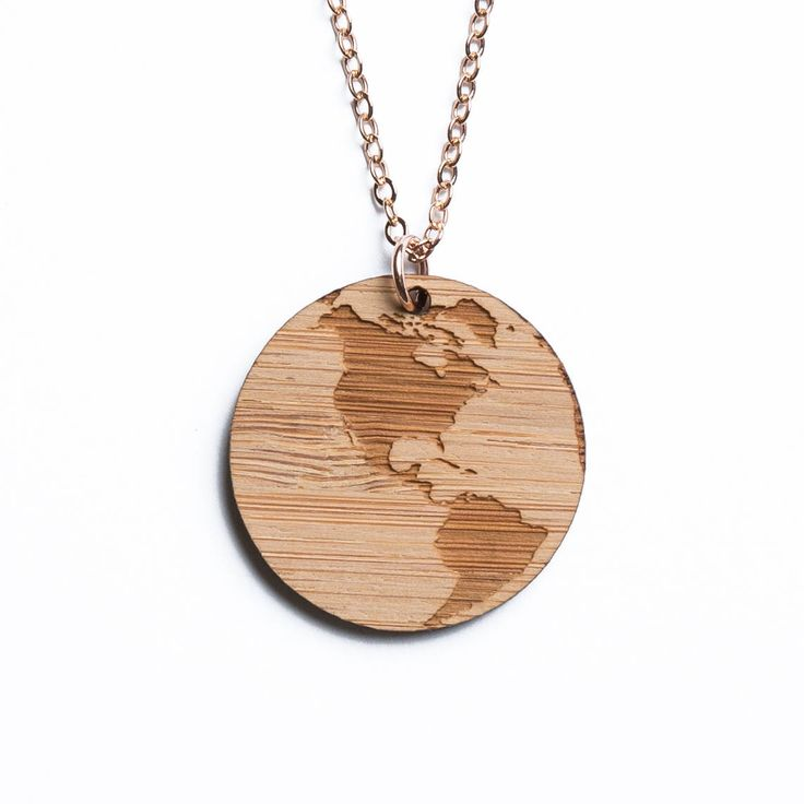 North America and South America map necklace, etched into eco-friendly FSC certified bamboo (using a laser burner), on a recycled rose gold plated sterling silver chain.