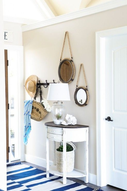 Walls Painted BM Muslin Cottage Foyer Features Round Rope Mirrors Mounted  On Beige Walls Over Whitewashed Half Moon Console Table With Contrasting  Black Top ...