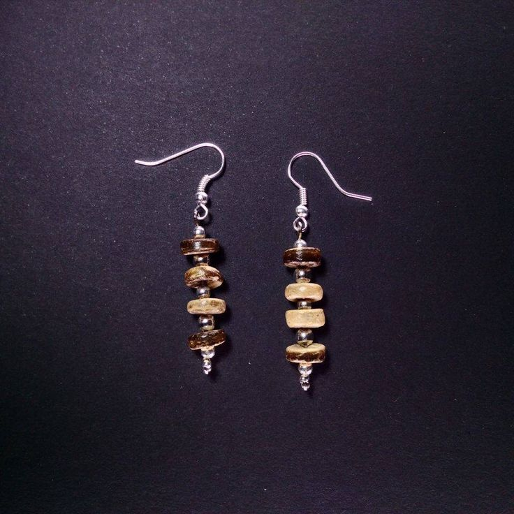 Earrings by Skitsanos. Coconut shell
