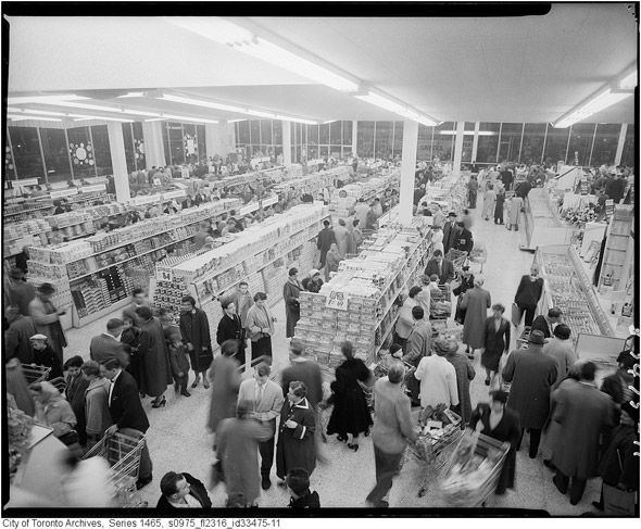 A big crowd of shoppers at the Dominion grocery store at Cloverdale Mall.