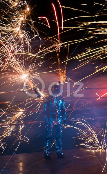 Qdiz Stock Images Fire show,  #alien #background #black #blurred #bright #burn #burning #danger #dark #decoration #effect #energy #entertainment #erupting #explosion #fantasy #festival #fire #fireshow #firework #glitter #glowing #holiday #hot #igniting #illuminated #imagination #industrial #inferno #light #lights #luminosity #magic #night #party #pattern #perfomance #plume #power #pyrotechnics #robot #shine #shiny #space #spangle #spark #sparks #tail #trail