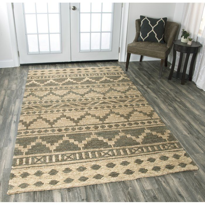 Southwestern-inspired patterns of zigzags, diamonds, and crosses give the Rayna Rug a dynamic look that's tempered by its neutral palette.