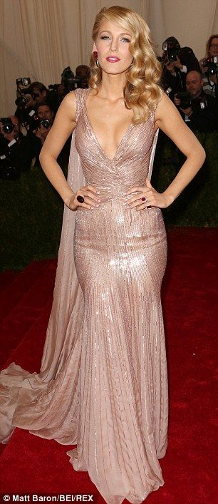 Striking: Blake Lively wore a champagne coloured sequined gown from Gucci - Met Gala 2014