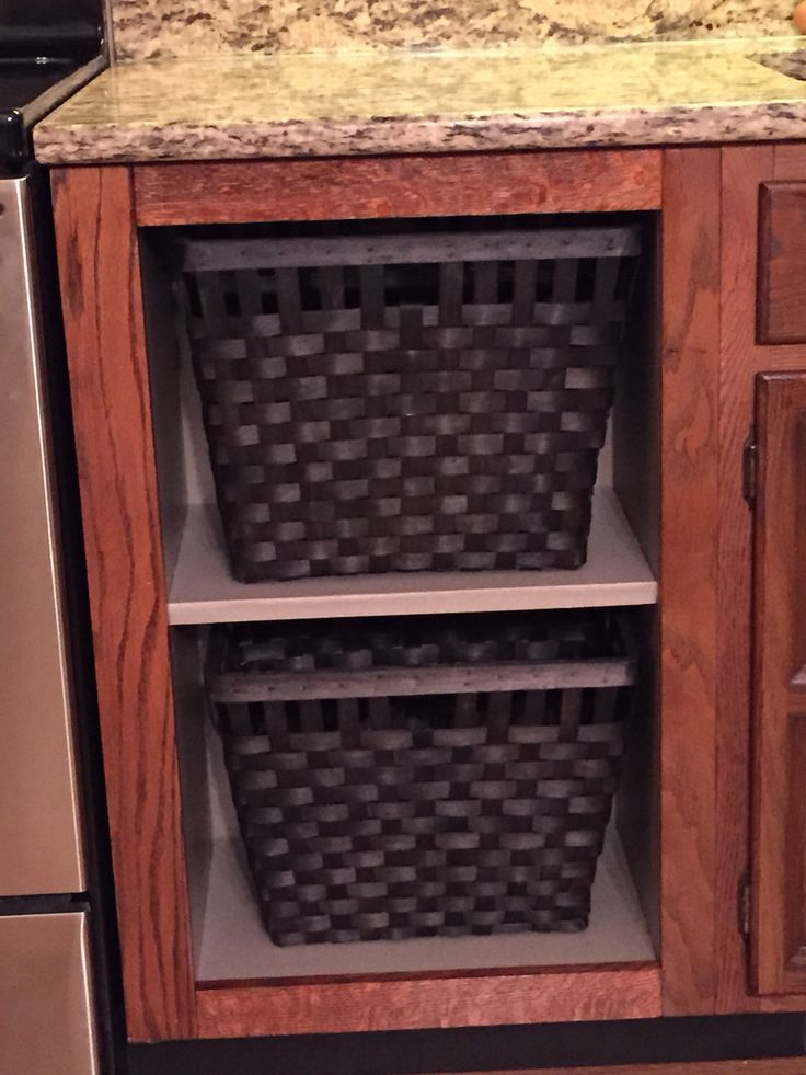 Trash compactor replacement. IKEA hack with stained trim to match existing cabinets, contact paper and baskets.