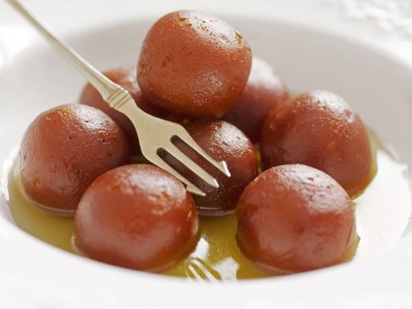 This tasty dessert is an Indian version of warm donuts floating in warm sweet syrup. Served as a dessert, this is a staple in most parts of India.