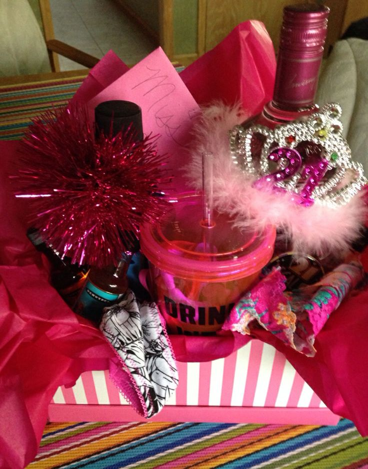 Vodka, Schnapps, Shooters, Sexy underwear,  PINK drinking glass, Bday Sash, 21 Crown & pin, And lots of pink decor! :) Perfect 21st Birthday present for a girl!