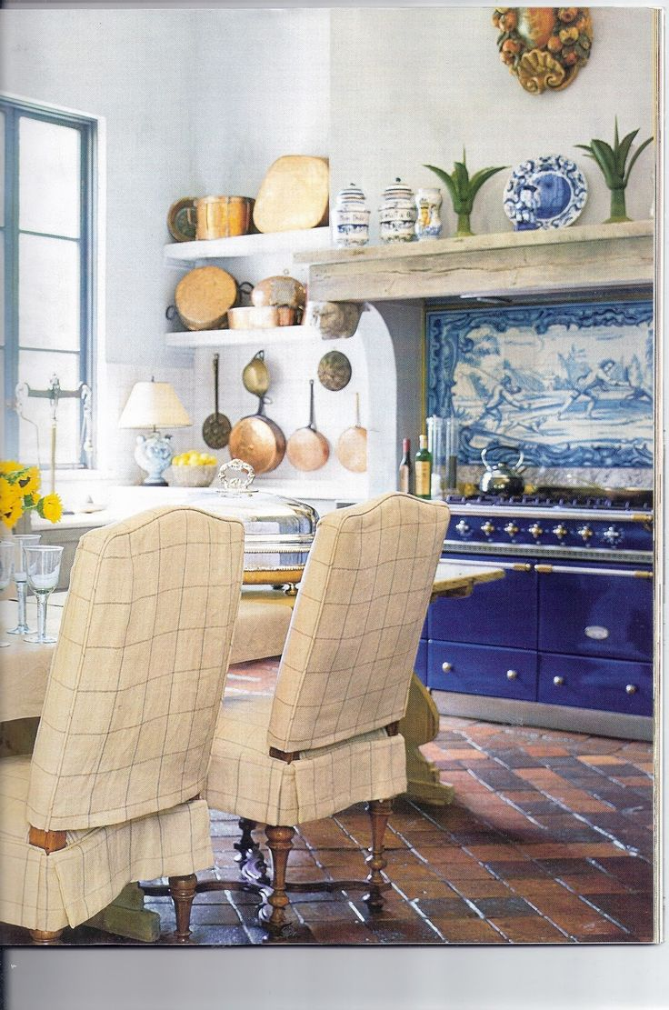A blue range with picture in Delft ware tiles as back splash Handmade tiles can be colour coordinated and customized re. shape, texture, pattern, etc. by ceramic design studios