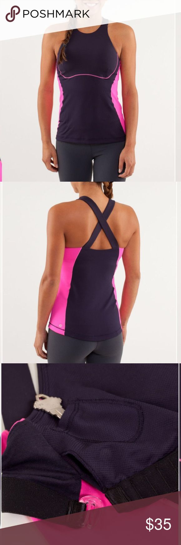 (Lululemon) Spin It To Win It Navy and Pink Tank Lululemon Spin It To Win It - Black Swan and Raspberry Glo Light. Size 4 customize the built-in bra for a personalized fit wide, crossover straps lay comfortably flat on your shoulders stash your key in the hidden bust pocket the silky-smooth Power Luxtreme fabric is quick drying and moisture wicking to help keep you cool and dry anti-stink Micro Diamond Mesh placed in high-sweat areas helps keep you cool rubber grip at the hem helps keep your…