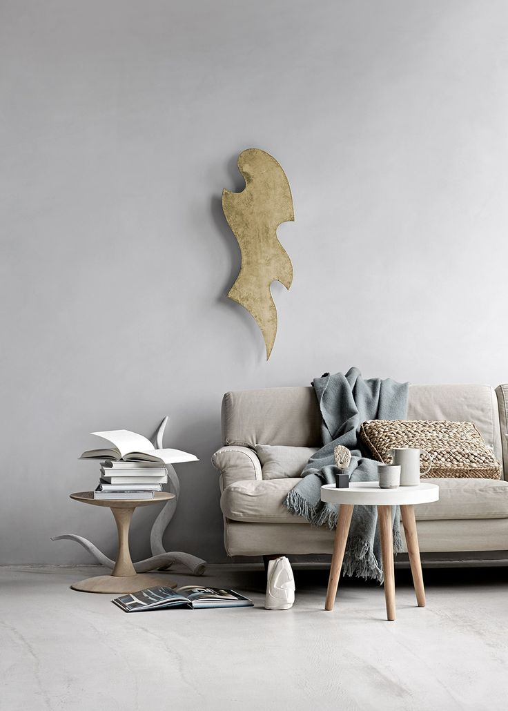 Move sculpture in patinated brushed brass. Feminine and cool shape.