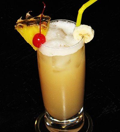Coco Loco Cocktail with Light & Dark Rums, Malibu Coconut Rum, Banana Liqueur, Pineapple Juice, & Cream of Coconut
