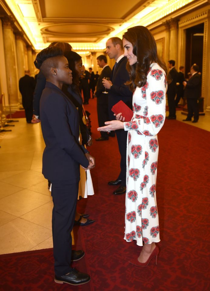 <p>Looking every inch the style queen in a long, poppy print Alexander McQueen dress, the Duchess greeted members of Team GB - including boxer Nicola Adams.</p><p><i>[Photo: PA Images]</i></p>