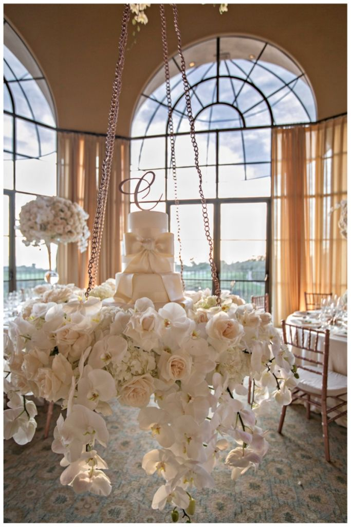 A Cake Suspended from the Ceiling with Flowers Cascading Down | Details Details | The Resort at Pelican Hill