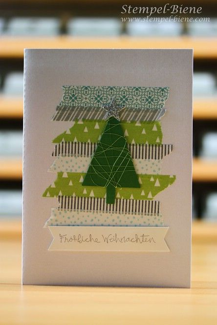 Stampin' Up! ... handmade Christmas card from Stamp Bee ... central focal point created with stripes of Christmas themed washi tape ... luv the punched tree wrapped in thread ...