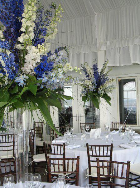Tall Wedding Centerpieces Royal Blue | tall pislner vase with blue, white & light blue delphinium