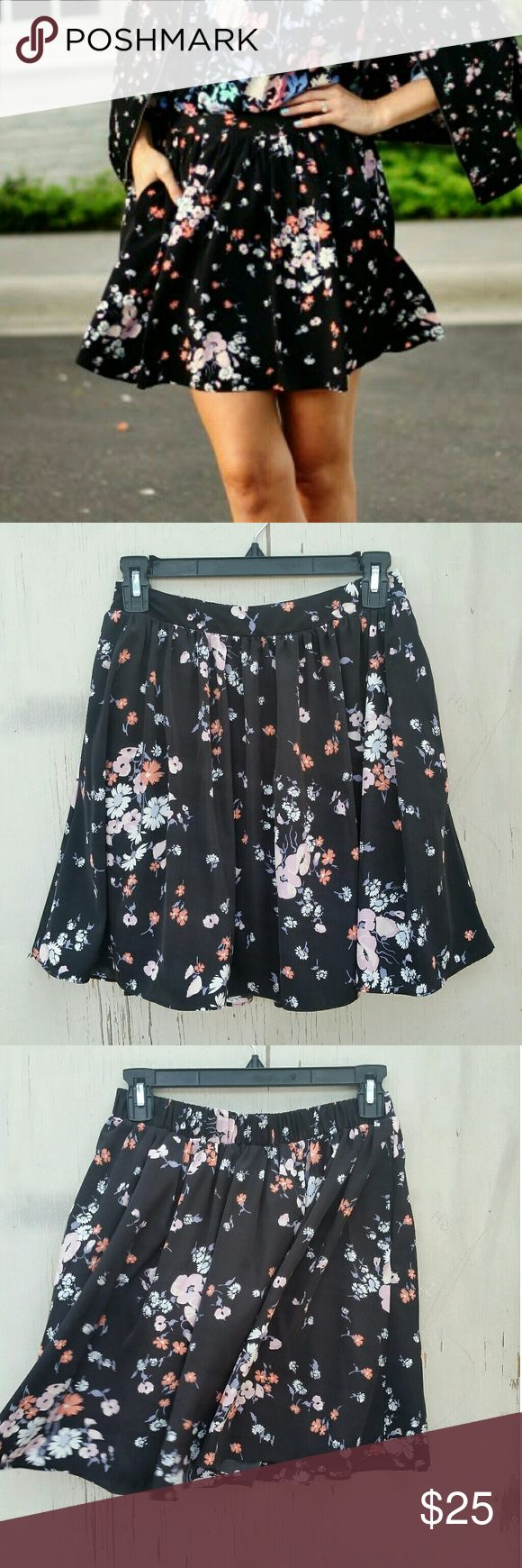 "♥Lauren Conrad Dark Floral Skater Skirt♥ Hi Poshers! I'm selling this adorable LC Floral Skater Skirt! It's size Xs but has elastic on the back part of the waist so it will be very comfy! Such a versatile Floral print also would look so cute with a denim shirt tucked in. measurements are 17.5"" from waist to hem. Waist is 13.5"" flat and about 17"" stretched . Great condition. Lauren Conrad  Skirts"