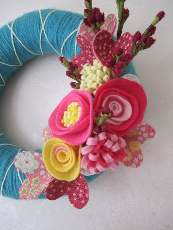 Oh my! I love this wreath! Teal Yarn Wreath with Pink Felt Flowers and by polkadotafternoon