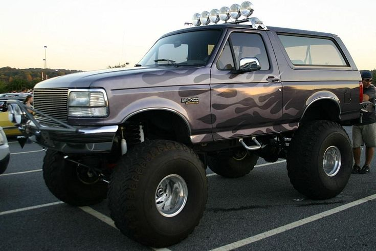 """Lifted Ford Bronco with a 31"""" XS in the grill, Flexible LED strips under the vehicle and a 30"""" XSR on the rear bumper! Description from pinterest.com. I searched for this on bing.com/images"""