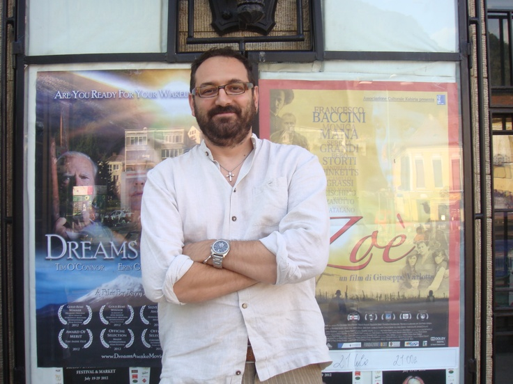 Italian Director Giuseppe Varlotta in front of his film poster, Zoe, and Dreams Awake, which was co-produced by Susan Johnston. Both films screened in Romania.