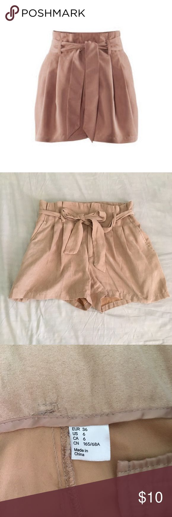 H&M High Waited Nude Shorts Material feels like suede or velvet. It's a cream beige color. Give your wardrobe a neutral flare. Feel free to comment :) H&M Shorts