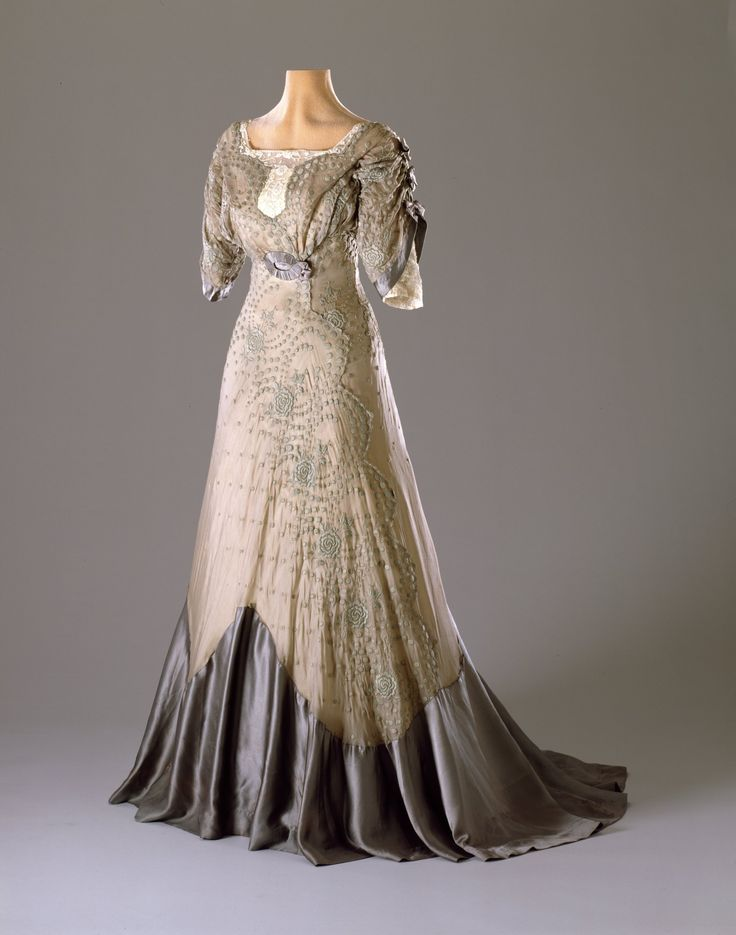 cheap tiffany charms A typical late Edwardian party dress with a high waist and fitted upper body placed on a boned bodice Other typical features are the short  quot tulip quot shaped sleeves and square neckline The under base of the skirt is yellow silk taffeta with an over layer of grey silk organza embroidered with flowers in green cotton thread