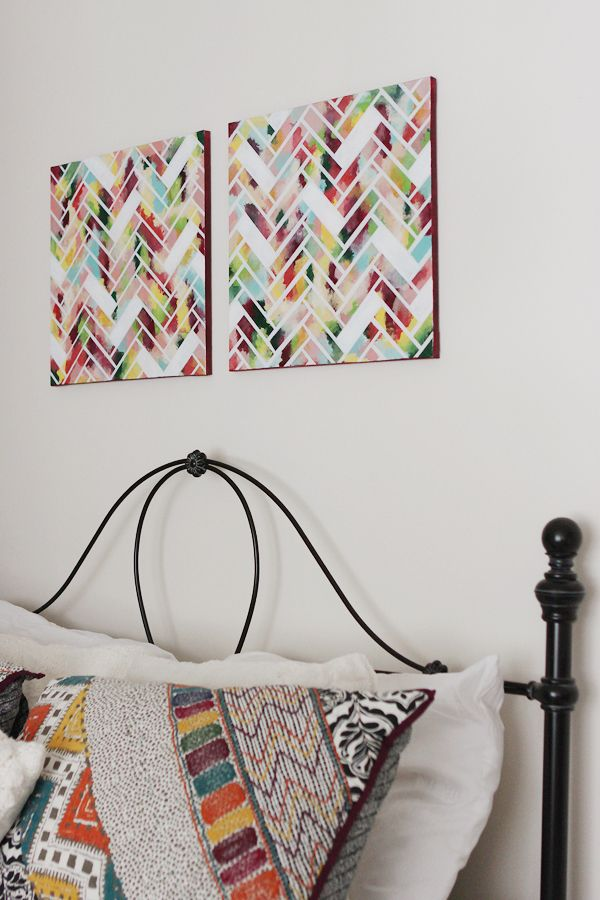 I can do this with my kid's canvas paintings .. excited.   1) Paint whole canvas in different colors  2) Cut strips of painter's tape of the same size  3) Tape them onto the canvas in a herringbone pattern leaving some out  4) Spray paint whole canvas in white.  5) Finish painting edges of canvas