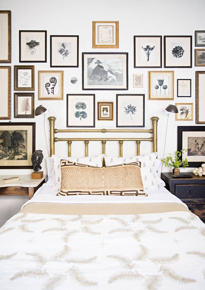 Gallery wall replaces the headboard. See more images from lauren liess: a must-see modern home renovation on domino.com