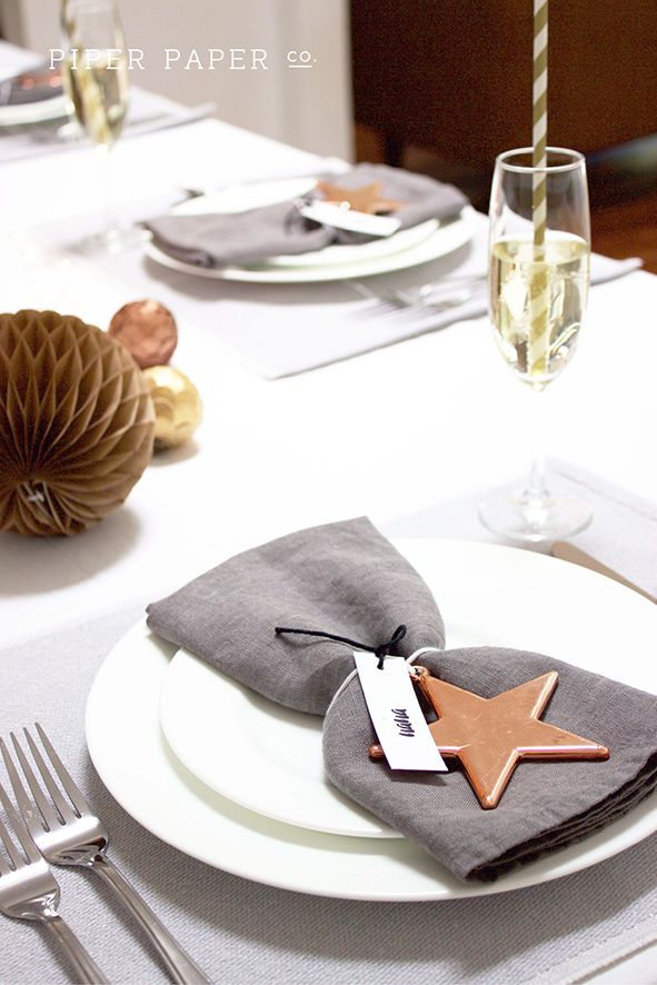 Personalised name tags and copper star ornaments make gorgeous place settings at Christmas. For more ideas check out Piper Paper Co.'s new Pinterest Board https://www.pinterest.com/PiperPaperCo/boho-christmas-christmas-styling-ideas-and-inspira/