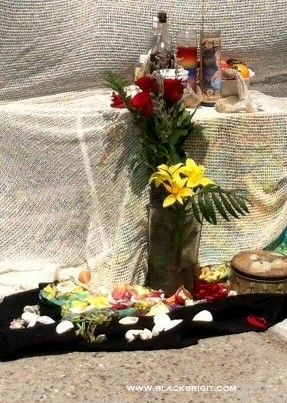 St. John's eve is the celebration of the longest day of the year. Here is a recipe for a special blessing water to create. Altar for Voodoo Queen Marie Laveau on St. John's Eve 2014 photo by Lilith Dorsey. All rights reserved.
