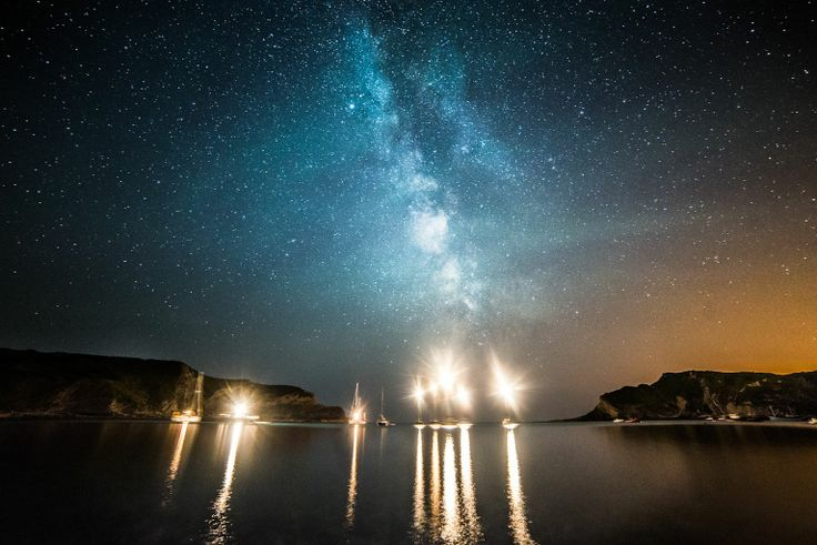 'Milky Way above boats in Lulworth Cove' by DorsetScouser. Taken at the height of summer at Lulworth Cove in Dorset. There were a fair few boats in the cove with a good group of them in the middle of the water. I lined up the Milky Way with them and took this shot.