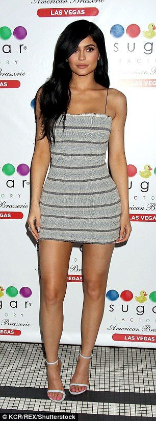 The 19-year-old reality television star put on a leggy display in a thigh-skimming form-fitting striped dress