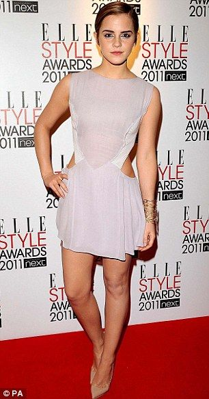 Changing shapes: Emma Watson says that despite her weight fluctuating between a size 10 [photo]and a tiny size 6, she has finally learned to be happy with her body