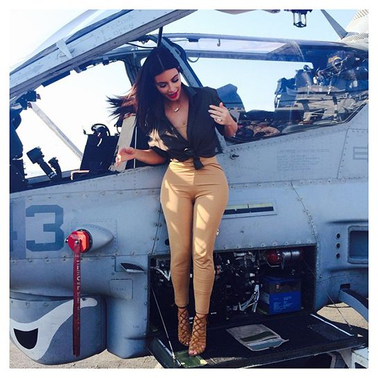 How Sweet Is Kim Kardashian's Visit To Troops In Abu Dhabi? #refinery29  http://www.refinery29.com/2014/12/78799/kim-kardashian-visit-troops-abu-dhabi#slide-5  [Ed. note: This image was captioned with a plane emoji, a rocket ship emoji, and a helicopter emoji.]
