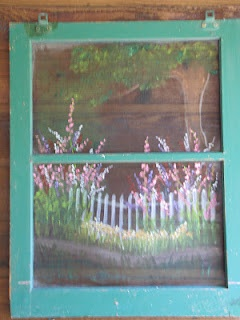 Custom painted old window screen.  Garden scene painted for Mother's Day.