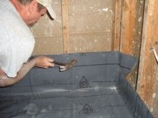 Install of flexible shower pan for accessible shower stall from tub conversion