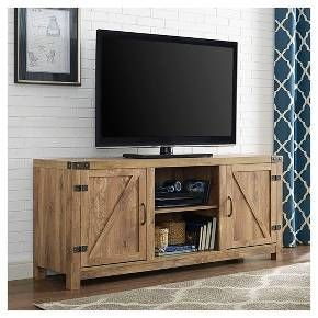 """Include our rustic barn door style TV stand in your home to not only enhance the décor of your living area, but create ample storage for all of your media, accessories, and more. Constructed of high-grade MDF, this durable, long lasting stand supports most TVs up to 65"""". It's the perfect addition that will keep your living room looking neat and give it a homespun feel."""