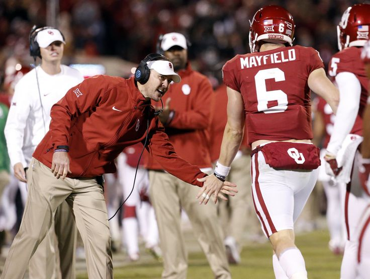 Coach Lincoln Riley congratulates Baker Mayfield after his touchdown run during the second half of a college football game in which the University of Oklahoma Sooners (OU) defeated the Texas Tech Red Raiders 49-27 at Gaylord Family-Oklahoma Memorial Stadium in Norman, Okla., on Saturday, Oct. 28, 2017. Photo by Steve Sisney, The Oklahoman